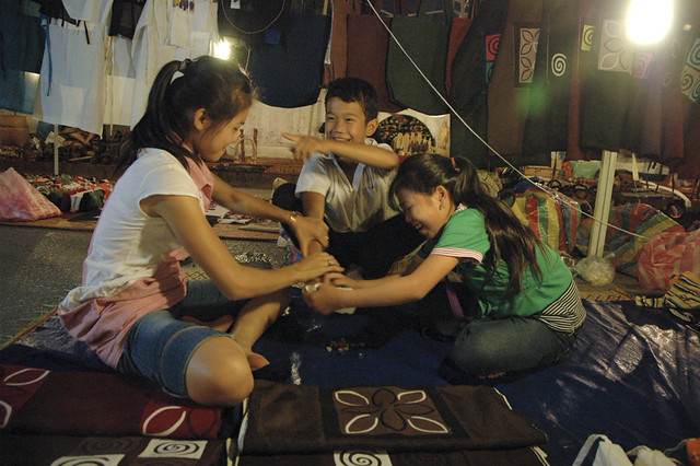 Kids play simple games at market