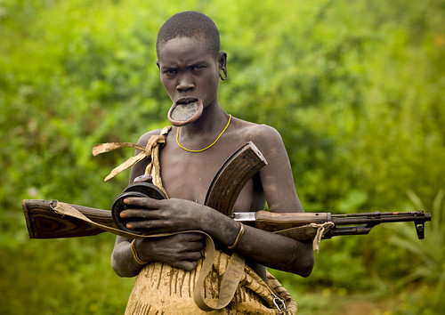 Mursi woman and Kalashnikov Ethiopia