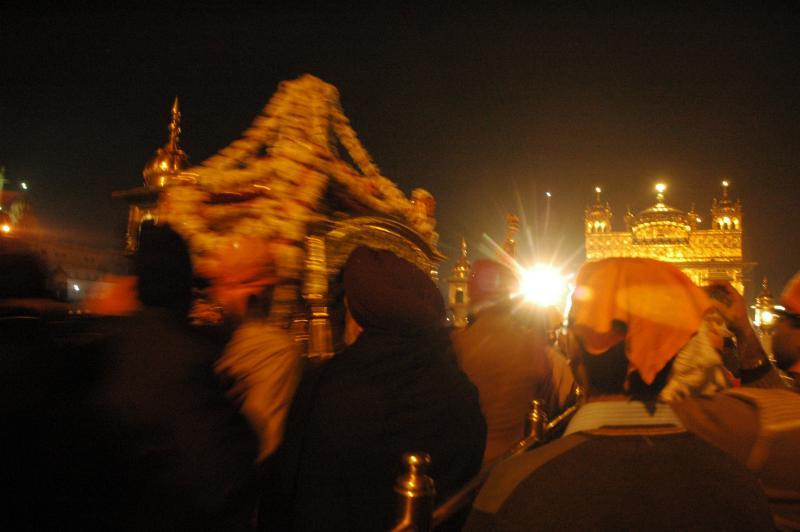 The Kar sevaks carrying Guru Granth saheb and putting to bed