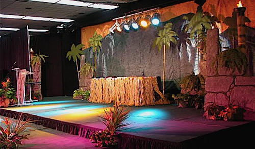 Tropical stage decor  Rock walls with caved Tiki gods