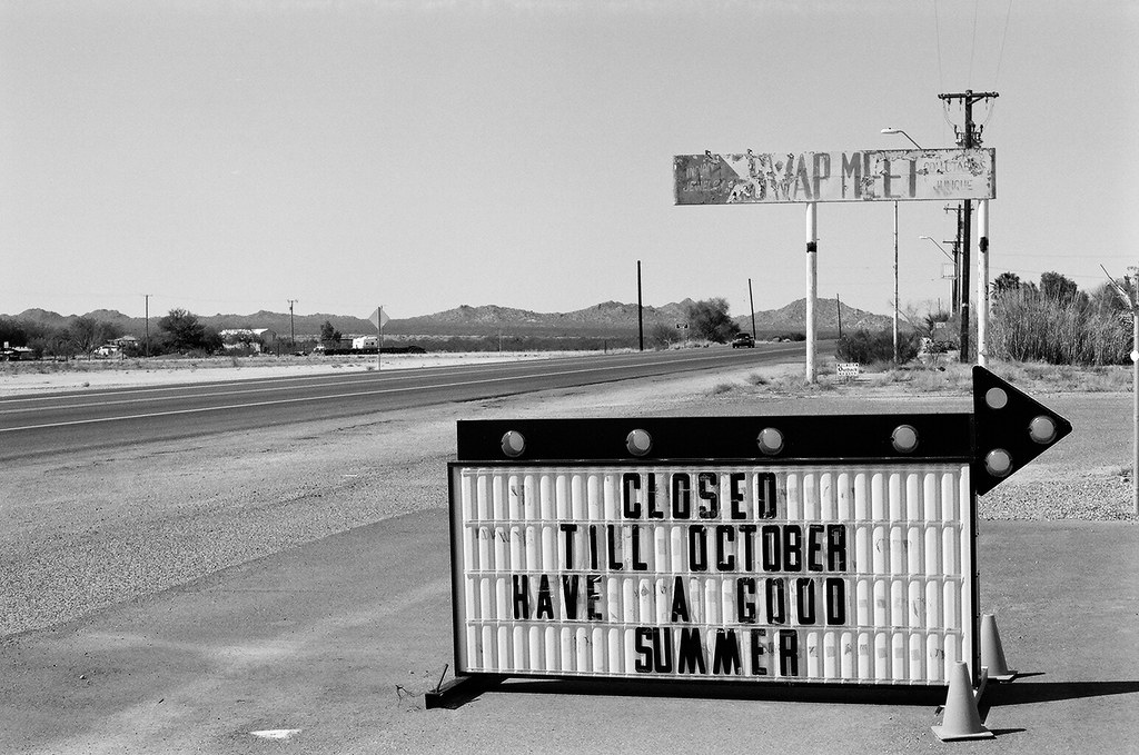 sign at swap meet indicating facilities closed till October