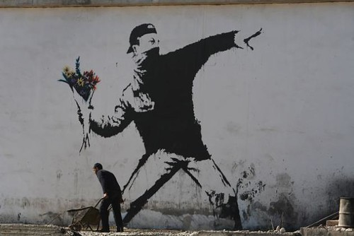 Banksy. Graffiti on a building wall in Bethlehem (2007)