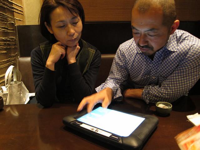 Sayoko and Hiko looking at the menu
