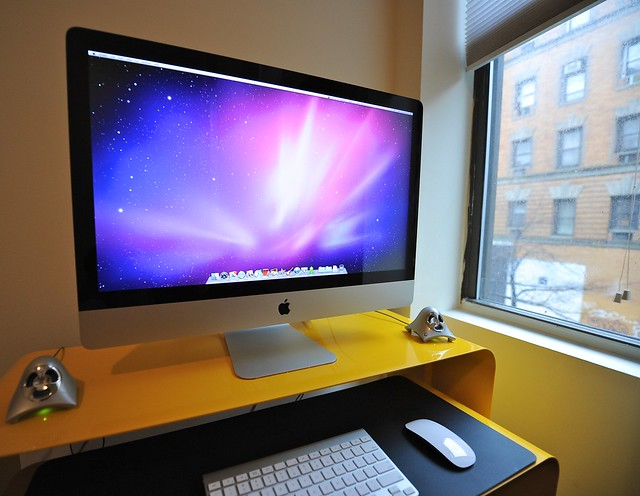 iMac computer on desk in office