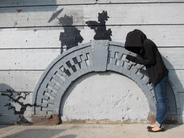 Banksy in Williamsburg, Silouettes on a Bridge: Art fan dressed as Banksy