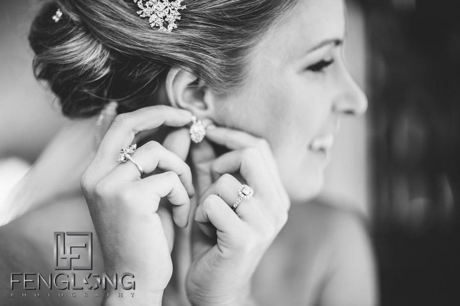 Bride fixes her earrings