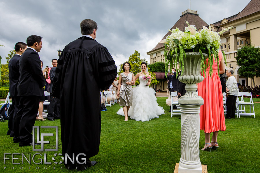Chinese bride and her mother walking down the aisle at an outdoor wedding at Chateau Elan