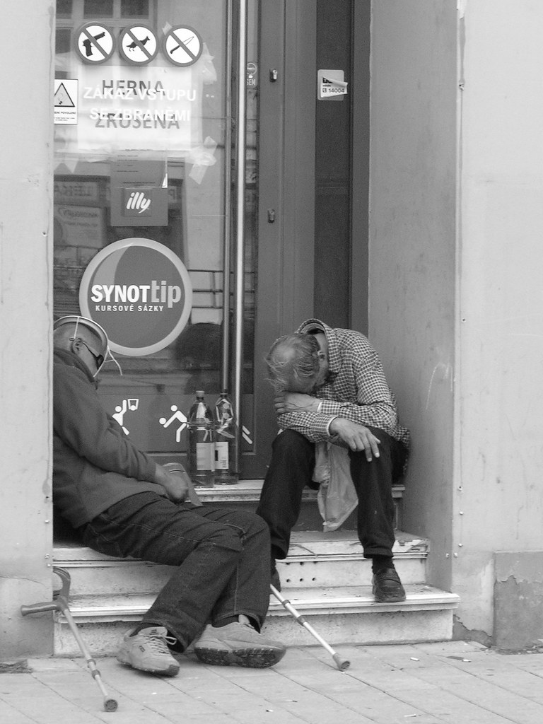 Two Man Sleeping in Front of Cancelled Gambling House 1