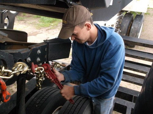 Brandon checks a chain binder