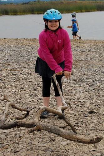 Girl dragging stick