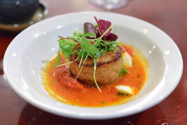 Crispy Duck Risotto duck confit risotto cake, herb salad, tomato puree