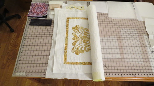 Using a Pool Noodle to Store a Quilt