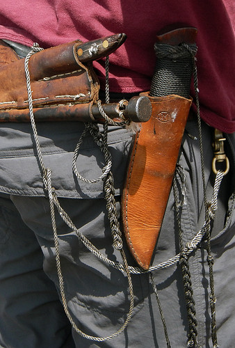 decorative knotting extends to the ship's worker's clothing
