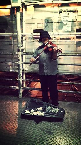 Violin station in Jakarta by Arnaldo Pellini