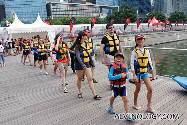 Happy group, heading off to try out canoeing on Marina Bay