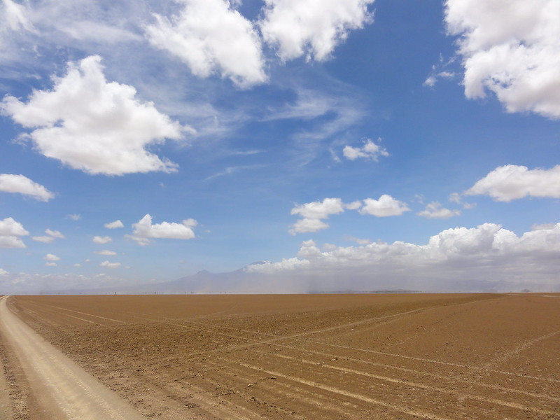 Flat and dusty, kinda like Qatar (plus clouds and mountains)