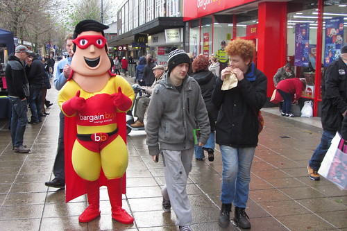 Bargain Buys opening day, Ashton-under-Lyne: BB Mascot and potential shoppers