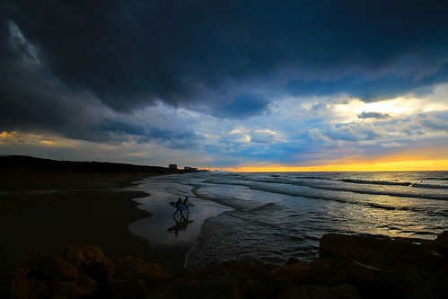going to surf in the stormy weather - Hertzelia beach - Israel