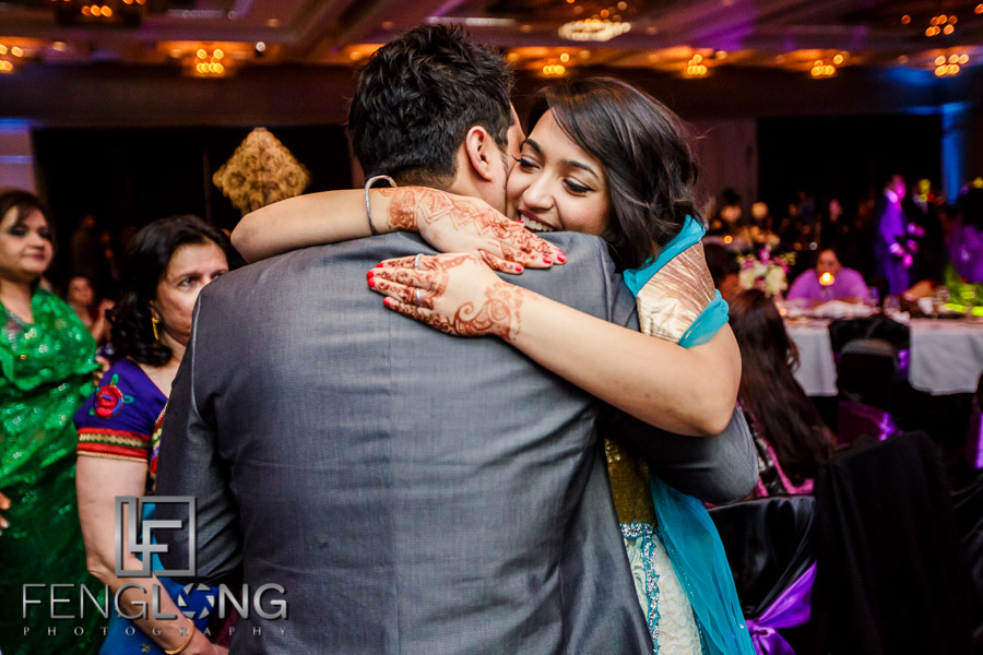 Groom hugs his sister
