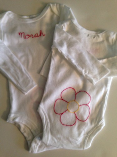 baby onesies: flower w/name
