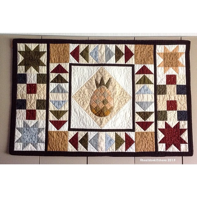 """Nov 16 - wallhanging {This is of my own design. It was made for an awkward space on the wall. I call it """"Welcome to the County!""""  It one the second place ribbon at our local quilt show.} #photoaday #princeedwardcounty #wallhanging #winner #quilt #pineappl"""