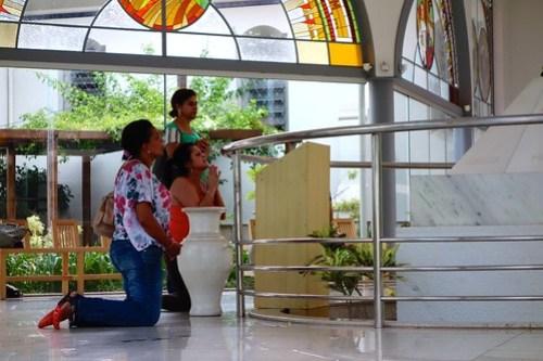 People from Belo Horizonte praying at tomb of Padre Eustaquio