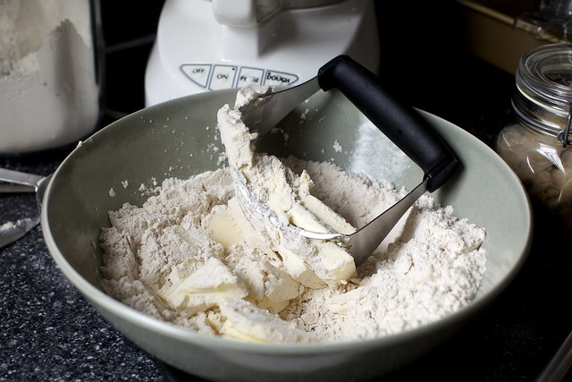 cutting butter into flour and spices