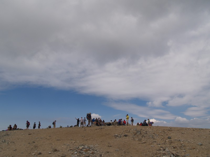 A huge Saturday crowd of people on the summit of Mt. Baldy.