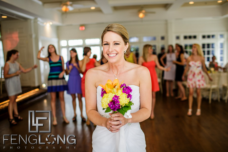 Bride about to throw her bouquet at the wedding reception