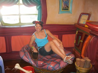 Me sitting in Pluto's bed.