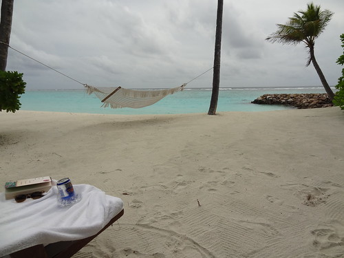 Our private beach with hammock and lounge chairs