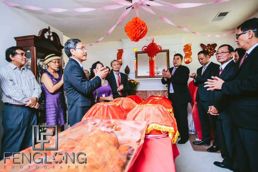 Families exchange gifts during Vietnamese wedding tea ceremony