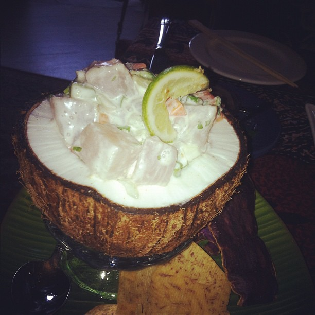 Inside Mama's Fish House - fresh Ono with coconut milk, lime, tomatoes and Maui onions. Oh yeah, and served in a fresh coconut.