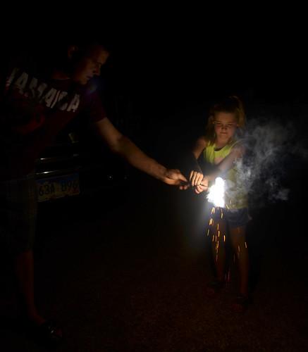 Leon gets a sparkler ready for Kaitlyn