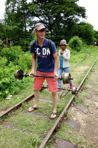 Lifting the metal axes….Bamboo Train in Battambang, Cambodia