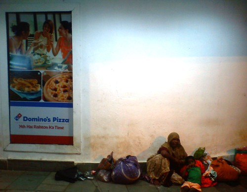 Beggar outside Domino's Pizza by shrihari Pathak