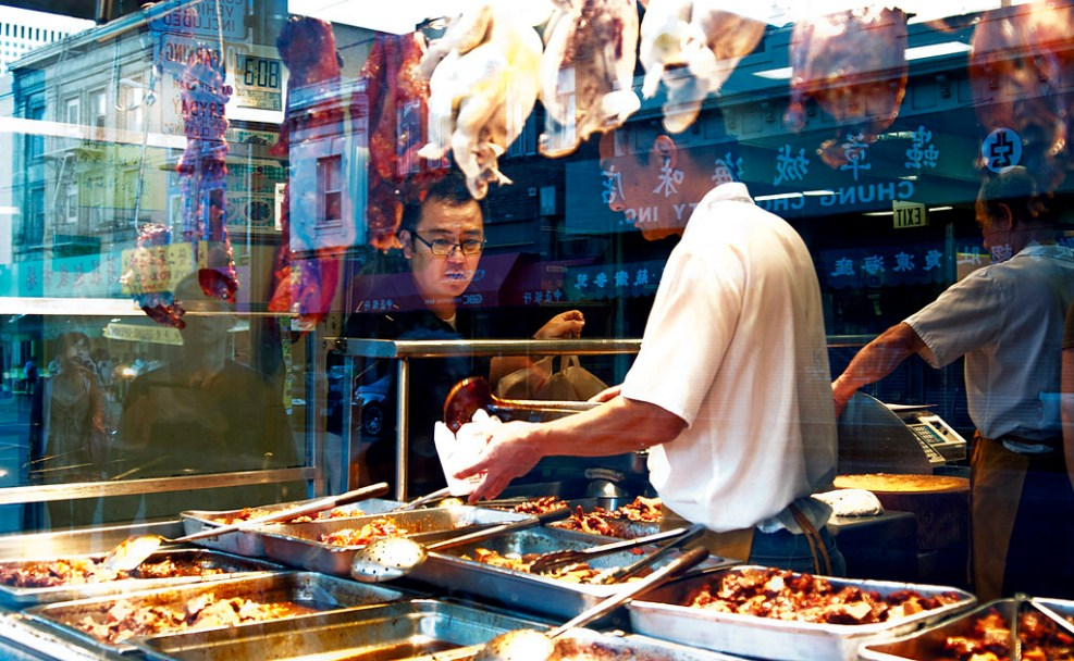 A man purchases a meal at a restaurant in San Francisco's Chinatown. Photo by Jessica Worthington / Xpress