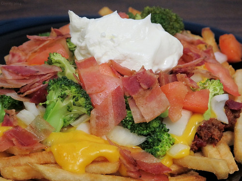 Loaded cheesy chili fries by Coyoty