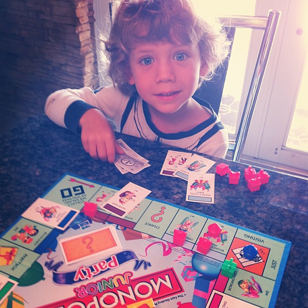 """Finn's plays his first game of Monopoly (Monopoly Junior Party edition). The """"properties"""" are bounce houses, dance parties, and magic shows, but it's still about competition and luck. (Sigh)."""