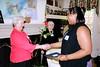05  Winner Jelani McMath receiving her rose from Danuta Buzdygan while President Reba Lippincott looks on.