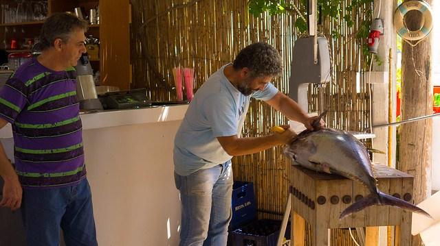 Carving up a yellowfin tuna at Moutsouna, Naxos