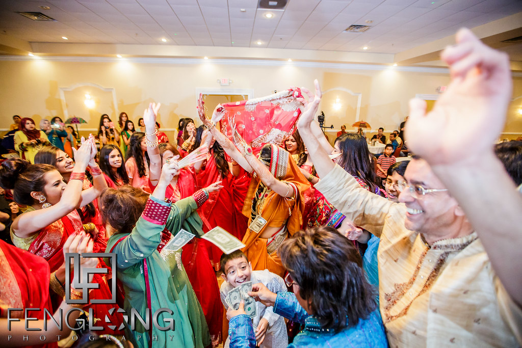 Bride and bridesmaids dance on the dance floor during entrance on Mehndi night at Seasons Event Center