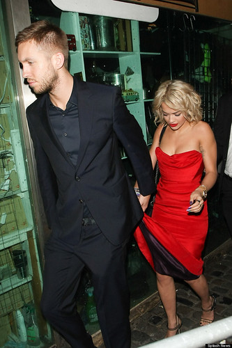 Rita Ora and Calvin Harris pictured leaving Nobu Berkeley restaurant and arriving at Proud Camden Galleries in Camden, London, UK