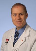 Dr. Charles Kahi