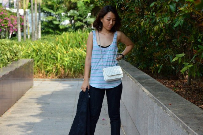 ladies pant suits navy, striped green tank top, white cross body bag