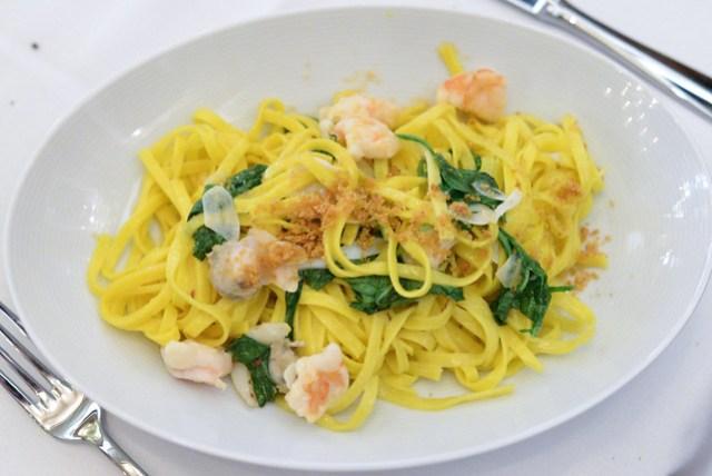 LINGUINI DE SUD lemon saffron pasta, clams, shrimp, shaved bottarga, sea beans, wilted arugula