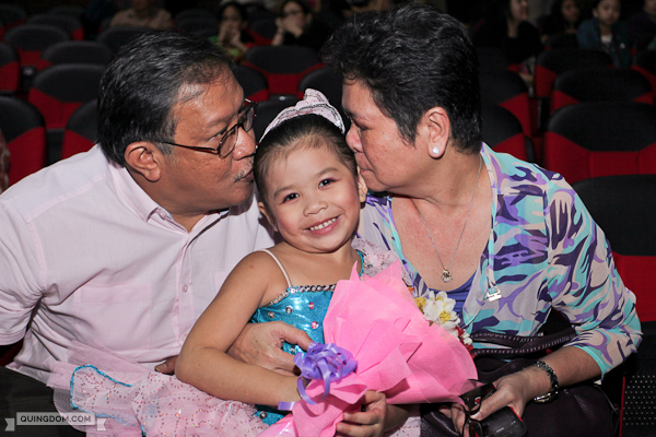 Julia gets kisses from her proud Lolo and Lola