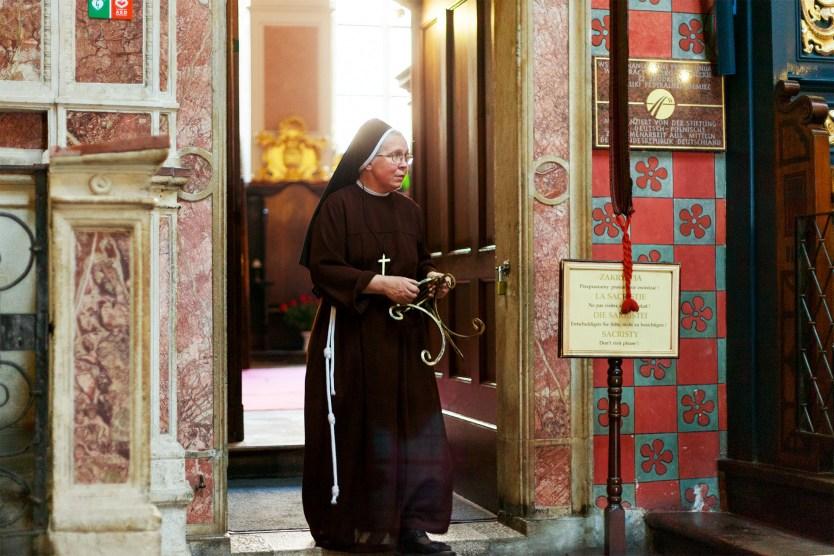 Nun inside Wawel Cathedral, Krakow.