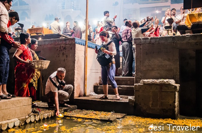 foreigners floating lamps in ganges at Evening Ganga Aarti Dashashwamedh Ghat Varanasi