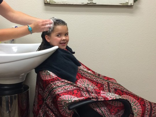 getting her hair washed